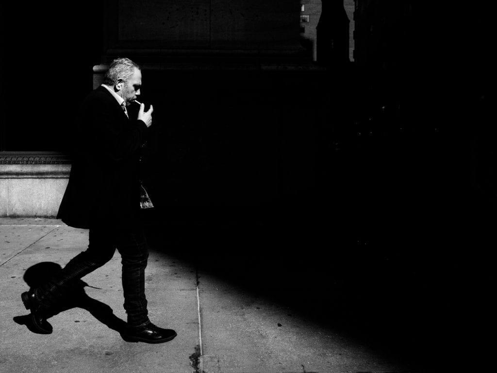 strong shadows harsh light street photography